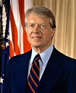 Former President Jimmy Carter, shown in his presidential portrait, recently announced the cancer found in his liver had spread to his brain.